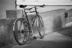 Close up vintage bicycle laying near a wall,black and white picture style,dark edges,selective focus Royalty Free Stock Photos