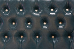 Close up of vintage black leather armchair Royalty Free Stock Photos
