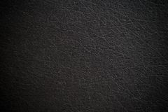 Black leather. Close up vintage of black leather notebook texture background use for your texts display stock photos