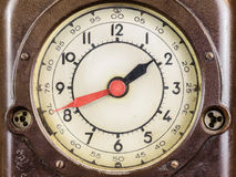 Close up of a vintage brown bakelite clock. With red minute hand Stock Photo