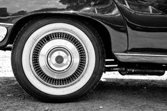 A close up of vintage cars whitewall tire. A black and white close up of vintage cars whitewall tire, showing detailing Royalty Free Stock Images