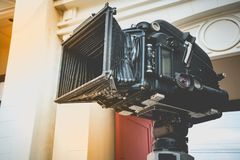 Close up of vintage classic mobile movie film projector with vintage color style. Old vintage rolling film cinema projector with c Royalty Free Stock Photos
