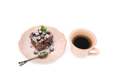 Close-up of vintage cup of coffee and chocolate cake isolated on white background. Stock Images