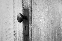 Close up of vintage Doorknob. On wooden door Stock Photography