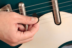 Close up of a vintage electric guitar being played Stock Photos