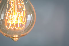 Close up of vintage glowing light bulb. Illuminated Royalty Free Stock Image