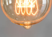Close up of vintage glowing light bulb lighting. Close up of vintage glowing light bulb Stock Photos