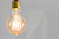 Close up of vintage glowing light bulb lighting. Close up of vintage glowing light bulb Royalty Free Stock Photos
