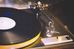 Close up at vintage gramophone. playing old song,Vintage record player with vinyl disc. Royalty Free Stock Photo