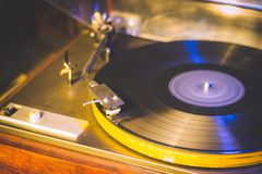 Close up at vintage gramophone. playing old song,Vintage record player with vinyl disc. Close up at vintage gramophone. playing old song,Vintage record player stock images