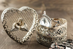 Close up of vintage heart shape jewelry box. On wooden background Royalty Free Stock Photos