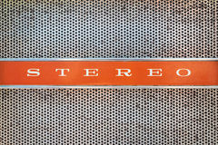 Close up of a vintage jukebox with the text stereo. On an orange background Royalty Free Stock Photo