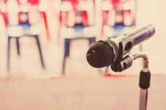 Close up of the vintage old microphone in conference room Stock Photos