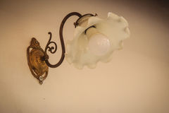 Close up vintage old white lantern lamp in flower shaped and its. Base was fixed on the white wall Stock Photography