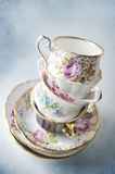 Vintage tea cups stacked up Stock Images