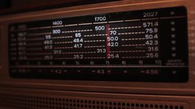 Close up of a vintage radio dial with the stations and frequencies being tuned. Searching Radio Waves. Full HD Resolution 1920×1080 Video Frame Rate 29.97 stock video