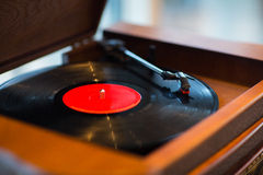 Close up of vintage record player with vinyl disc Royalty Free Stock Photos