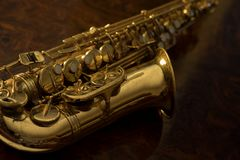 Close up of vintage saxophone. Golden saxophone on a wooden background Stock Images