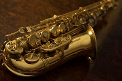 Close up of vintage saxophone. Golden saxophone on a wooden background Royalty Free Stock Photos