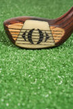 Close up of a vintage three wood golf club at address. A vintage wood three wood at address Royalty Free Stock Photo