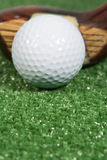 Close up of a vintage three wood golf club with ball. A vintage wood three wood with ball Stock Photo