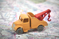 Close-up of a vintage toy tow truck. On a road map Royalty Free Stock Photos
