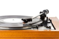 Close up of vintage turntable vinyl record player isolated on white. Wooden plinth. Retro audio equipment stock image