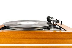 Close up of vintage turntable vinyl record player isolated on white. Wooden plinth. Retro audio equipment stock photos