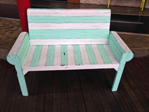 Close up vintage white and green wooden bench. Beautiful close up vintage white and green wooden bench Stock Image
