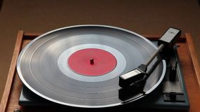 Close up of a vinyl deck playing a record. Close up of turntable needle on vinyl plate stock video footage