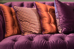 Close up of violet velvet sofa and cushions. With vintage style Stock Photography