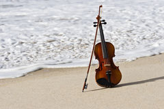 Close up of a Violin and the Atlantic Seashore Royalty Free Stock Photo