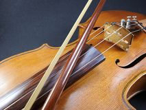 Close-up of a violin and a bow. royalty free stock photo