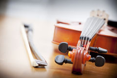 Close up of violin with a fiddlestick Royalty Free Stock Image