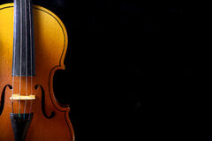 Close up of a violin isolated on black Royalty Free Stock Image