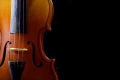 Close up of a violin isolated on black Royalty Free Stock Photo