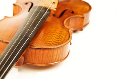 Close-up of the violin over white Royalty Free Stock Photography