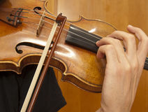 Close up on violin playing Stock Photos