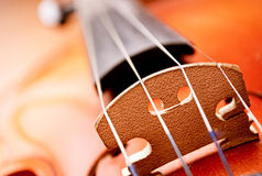Close Up of Violin Scroll and Bow Stock Photography