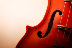 Close Up of Violin Scroll and Bow Royalty Free Stock Image