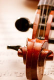 Close Up of Violin Scroll and Bow Royalty Free Stock Photos