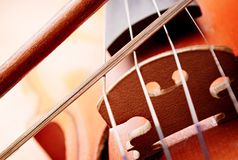 Close Up of Violin Scroll and Bow Stock Image