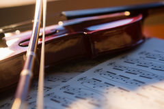 Close up of violin with sheet music Royalty Free Stock Photo