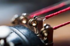 Close up of violin strings at the base. Close up of the ends of the strings on an antique violin stock image