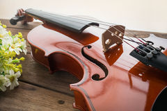 Close up of violin on wooden table Royalty Free Stock Photos