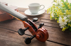 Close up of violin on wooden table and coffee cup Stock Image