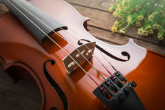 Close up of violin on wooden table Stock Image