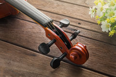 Close up of violin on wooden table Royalty Free Stock Photo