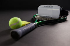 Close up of virtual reality headset on tennis racket by ball Stock Photography