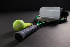 Close up of virtual reality simulator on tennis racket by ball Stock Images